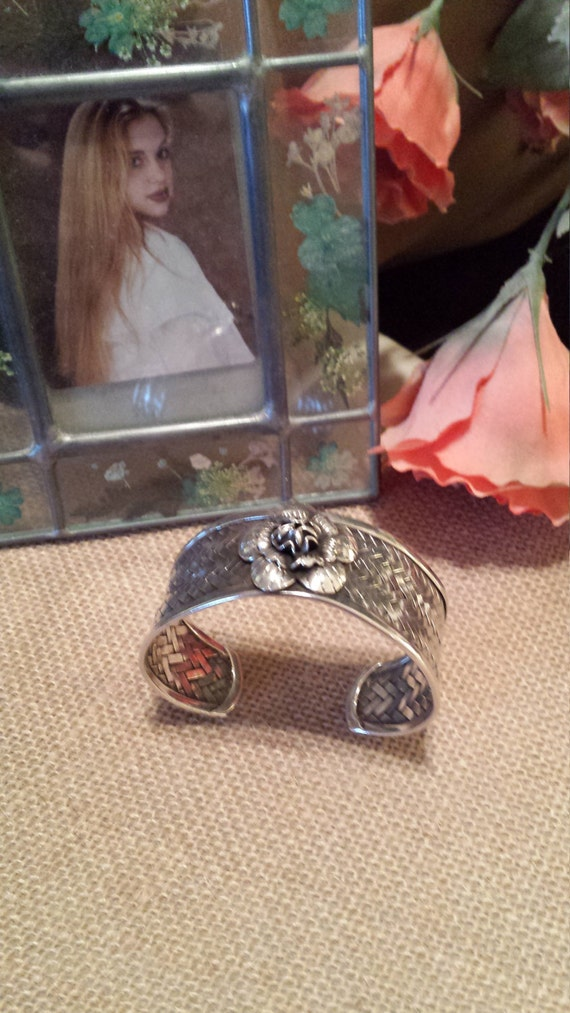 Sterling silver weave cuff with floral center