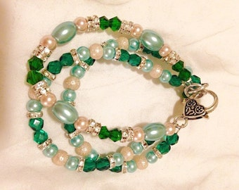 Emerald and mint triple strand bracelet with lobster claw closure