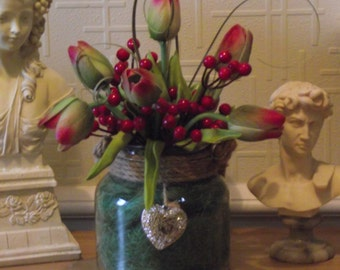 Flower arrangement of red and green top quality artificial real touch tulips and red berries in a quality glass vase