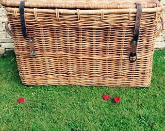 A Large  Wicker/Cane Storage Basket