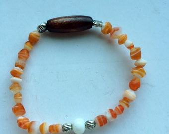 orange and white stretch bracelet