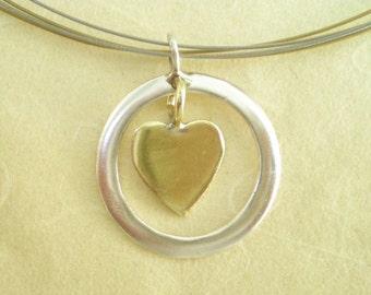 Handmade Silver Pendant with a Brass Heart