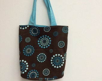 brown and blue tote bag