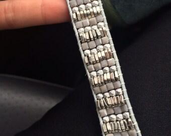 All silver woven bead bracelet