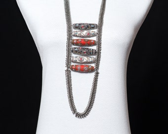 Antique silver necklace decorated with beads