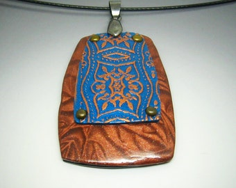 Copper fleur de lis pattern polymer clay pendant necklace in copper, turquoise and gold with brass rivets