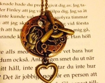 Steampunk pendant necklace with propeller, watch parts and dangle heart charm