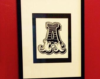 Framed black and white letter prints