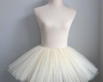 Cream Tutu  Over 100 yards of tulle per skirt.2-3 years