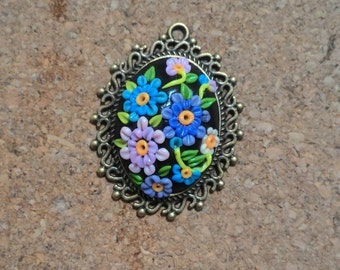 polymer clay handmade pendant with floral pattern