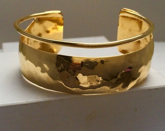Gold plated brass cuff bracelet.