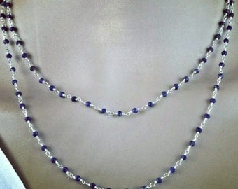 Delicate hand-made necklace with precious stones: sapphires