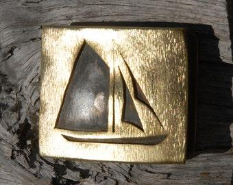 Sailboat belt buckle - hand-cut brass - gaff-rigged cutter