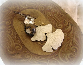 mergers & acquisitions one of a kind vintage assemblage earring . rhinestone antique mother of pearl button + guilloche over sterling ginko