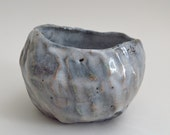 small raku fired ceramic bowl