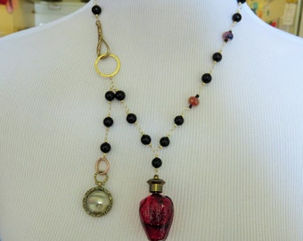 Huge vintage Strawberry Perfume Bottle and vintage Painted Eye Locket and Gold Necklace