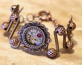 Steampunk Jewelry -  Bracelet - Antique watch movement and ruby red swarovski crystal