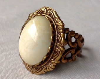 oO LOTUS Oo cream/white glass cabochon medieval brass ring
