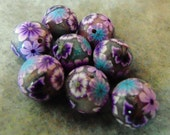 round and foiled polymer clay beads with flowers and butterfly