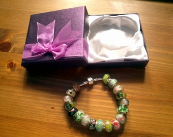 Stunning Earthy Hedgerow Florals Summer charm bracelet. Snake Chain with snap closure. Gift boxed.