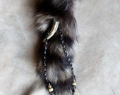 Real raccoon fur tail hair charm clip with deer antler, glass beads and rooster feathers for costuming, ritual, dance and more