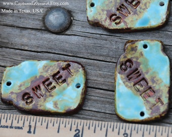 Handmade Old Fashion Jar Shapped Pottery Bead for a PENDANT with the word SWEET in a worldly mix of blues, greens and browns