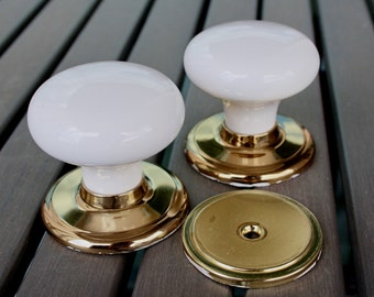 2 x Porcelain and Polished Brass Dummy Door Knobs