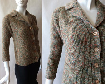 1960's wool boucle cardigan in variegated green, with notched collar, hip pockets, and 3/4 sleeves, women's small / medium