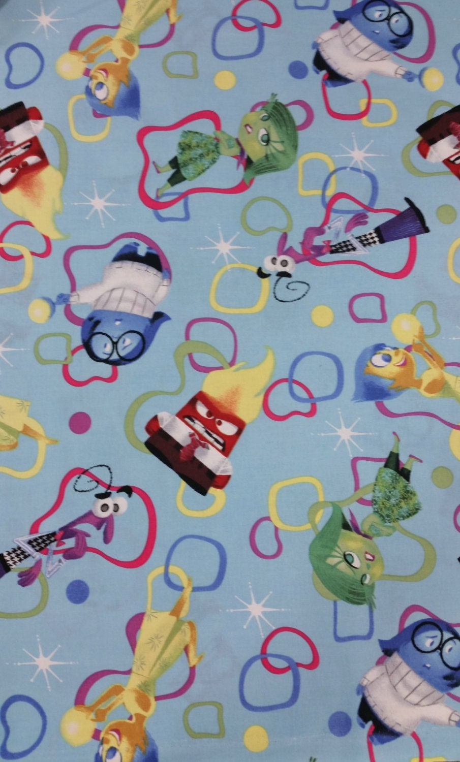 Cotton fabric inside out emotions amoeba disney character for Children s character fabric