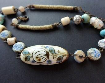 Palingenesis. Rustic folk choker necklace in light blue.