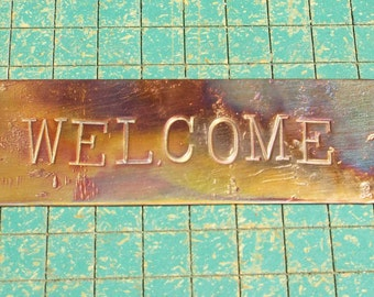 WELCOME, hand stamped copper, doorbell greeting sign