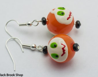 Sale / On Sale / Clearance Jewelry / Jewelry on Sale / Marked Down / Ghoul Face Orange Lampwork Glass Silver Plated Earrings - EA00392