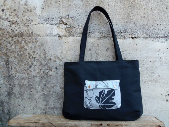 Grey shoulder bag made of fabric with leaves for autumn