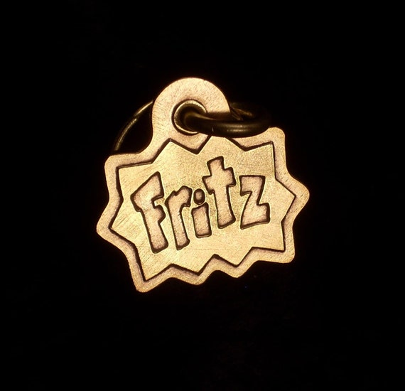 Comic book style brass pet tag