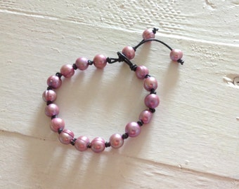 rose pearls on knotted leather bracelet