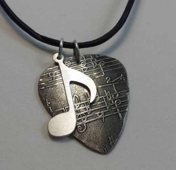 Sterling Silver Guitar Pick Necklace With Music Note Charm By