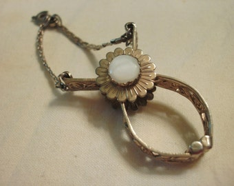 Vintage Gold Tone Filigree Glove Clip With A Bezel Set Mother Of Pearl Center Flower