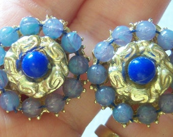 lavendar with blue center and gold tone cluster like clip on earrings 615B