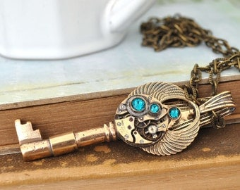 steampunk key necklace -THE TIME KEEPER - vintage brass skeleton key necklace with vintage mechanical watch movement and wings