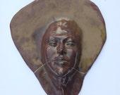 Wall hanging face sculpture, ceramic mask, kintsugi gold crack, emerging figure art