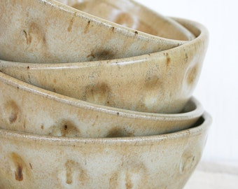 Set of four hand made stoneware bowls. Rustic, earthy, honey, caramel, speckles, wheel thrown, altered, dimples, soup, salad, serving
