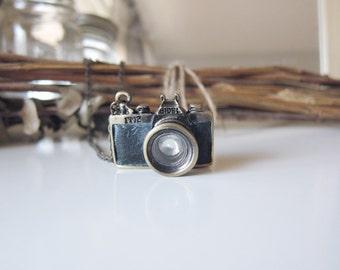 Black 3D Paparazzi Camera Necklace - Brass