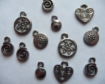 Drops, Charms, Cousin, Silver Plated Pewter, 2 Flowers Rounds, 2 Hearts, 4 Swirls, 2 Plain Disc, 2 Round Flowers, Pkg Of 12