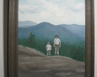 framed original oil painting of father and child on a mountain