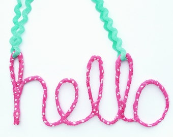 Fabric wrapped wire, cursive, script word hello