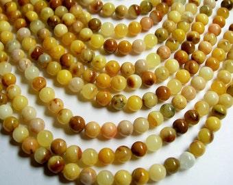 Orange Jade 6mm round - A quality - 66 beads per strand - Natural mix tone - RFG377
