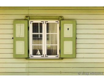 Fine Art Color Photography of a Little Sailboat in the Window of a Green Home in Haapsalu Estonia