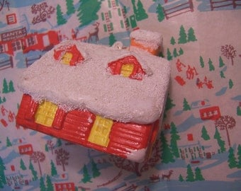 hollow plastic snow capped red house ornament