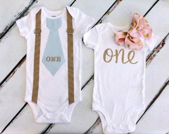 "Twins Baby Boy & Baby Girl 1st Birthday Sets.  Boy ""ONE"" Tie w Suspenders,  Girl Floppy Bow Bodysuits, Leg Warmers, Diaper Cover, Headband"