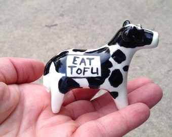 ceramic cow with Eat Tofu written on the sides